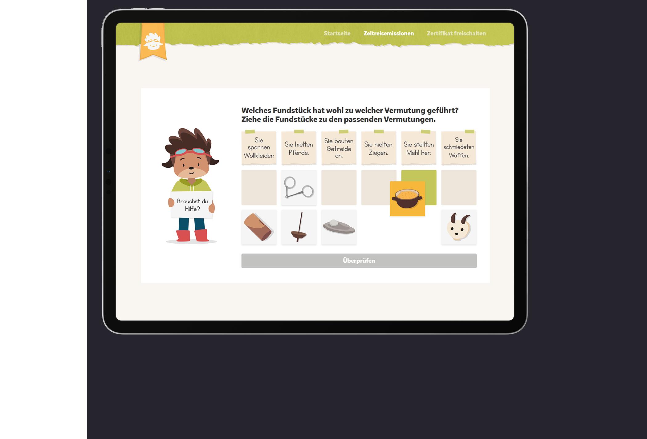 Titelbild: Ein iPad zeigt eine interaktive Aufgabe des Erklärvideos zur Höhensiedlung